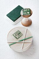 Chip wood box with printed motif reading 'For you'; hand-carved rubber stamp on wooden handle and ink pad in background