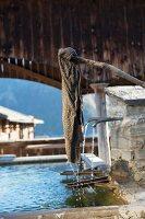 19th century village pump in Luven, Graubuenden canton, Switzerland