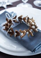 Napkin ring hand-crafted from beechnut shells and beads threaded on silver wire