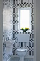 Guest lavatory with black and white graphic pattern on tiles