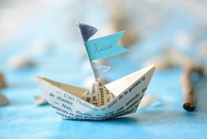 Paper boat with name on flag as place card