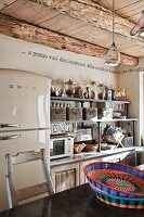 Kitchen with retro fridge and shelves of storage baskets above kitchen counter