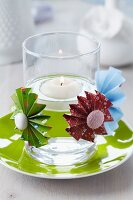 Colourful paper flowers with buttons as centres decorating candle lantern with floating lantern