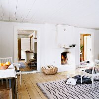 White, country-house interior with open fireplace