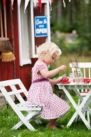 Girl playing in front of playhouse