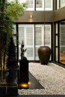 Zen garden in courtyard of contemporary house