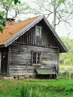 Old wooden cabin and bench