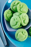 Green sweets with reliefs of apples