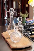 Empty decanters on wooden board