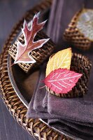 Napkin rings decorated with painted autumn leaves