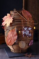 Bamboo lantern decorated with painted autumn leaves