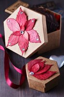 Colourful autumn leaves stuck on gift boxes