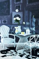 Modern, metal lattice chair and white, postmodern armchair at table with wedding symbols on top