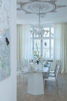 Table festively set in white