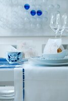 Festive place setting in white and blue