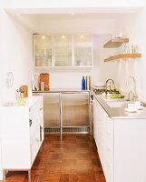 L-shaped kitchen counter with white and stainless steel doors