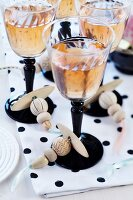 Wine glasses with threaded wooden beads tied around stems