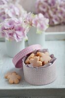 Semolina biscuits with rose syrup in tin with open lid