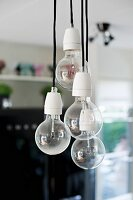 Pendant lamps ending in simple light bulbs