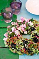 Autumnal wreath of snowberries, privet berries & hydrangeas