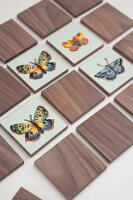 Hand-crafted, wooden pairs game set with butterfly motifs