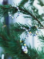 Glittery, sugar-bead hoops decorating Christmas tree