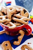 Alphabet biscuits in red teacup
