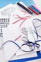 Printed invitation cards, envelopes and various ribbons