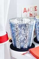 Glass candle lantern decorated with alphabet washi tape