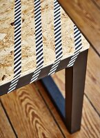 DIY bench with black-painted frame and pale chipboard seat decorated with washi tape