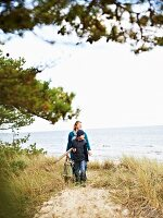 Mother and son on autumnal beach