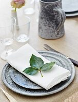 Festive place setting with rose leaves