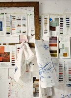 Sketches and colour samples hanging on wall