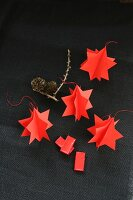 Hand-crafted, red paper stars