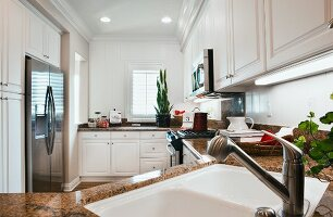 View of a kitchen with white cabinets; Burlington; Vermont; USA