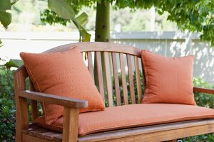 Close-up of a garden bench with cushions; California; USA