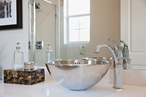 Close-up of stainless steel sink in the bathroom; Irvine; California; USA