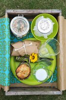 Drinks & food for picnic in wooden crate