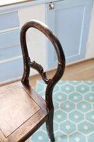 Antique, unpainted wooden chair in vintage, Nordic kitchen interior