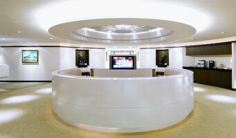 Reception area in modern office with light fixtures on ceiling