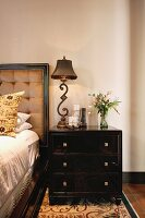 Bedside table with antique lamp