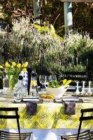 Yellow tulips on table in garden