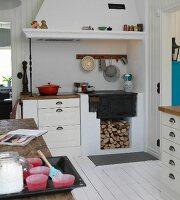 Masonry, country-house kitchen counter below mantel hood