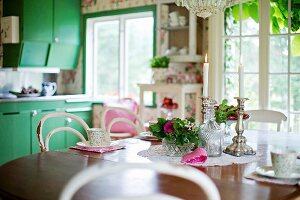 Table set with bowl of flowers and candles