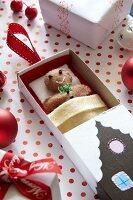 Felt gingerbread man in house made from matchbox