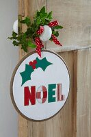Fabric Christmas decoration in embroidery hoop
