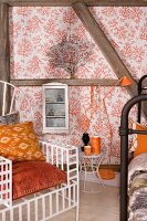 Throne-style armchair with orange cushions in front of half-timbered wall with wallpaper panels, retro standard lamp and white, glass-fronted cabinet
