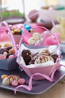 Easter sweets in paper baskets with handles