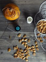 Pumpkin seeds and nylon thread: craft materials for making a pumpkin-seed garland