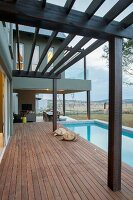 Contemporary house with pergola, wooden terrace and pool